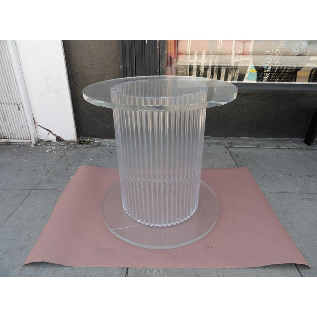 This is an amazing column-style solid Lucite center side table. It is comprised of several Lucite rods that are arranged...