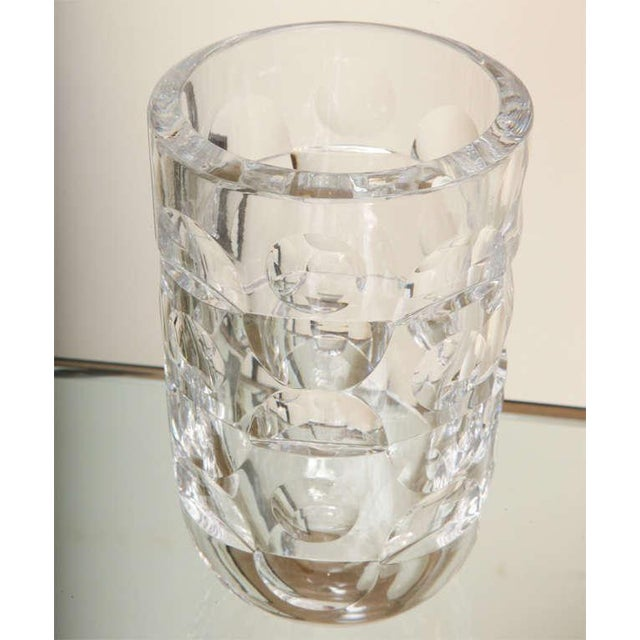 This heavy and signed modernist crystal Swedish Orrefors glass vase has incised half and full circles alternating...