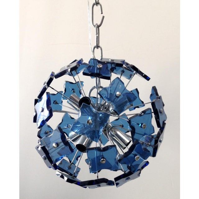 Vintage Italian sputnik chandelier with blue faceted glasses, mounted on chrome frame / In the style of of Fontana Arte /...