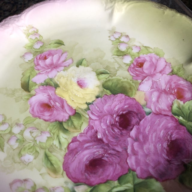 This stunning hand painted charger plate in gorgeous shades of pink and green is perfect for setting a pretty floral table...