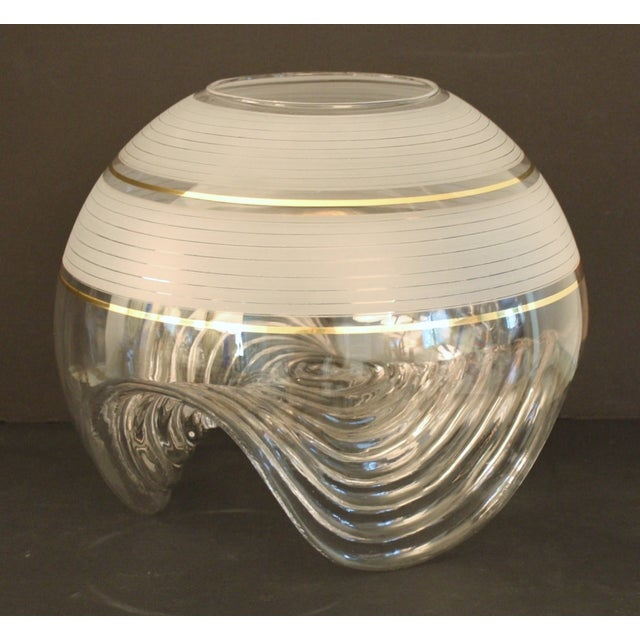 Large Murano centerpiece vase by Mazzega. The base is ribbed and in a wave form with the top having applied bands of...