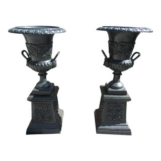 Pair of Cast Iron Urns With Handles on Pedestal Bases For Sale