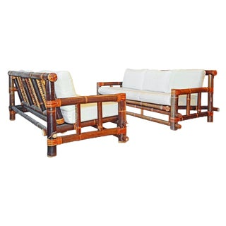Pair of Tropical Traditionally Joined Bamboo Pole Sofas With Off White Cushions For Sale