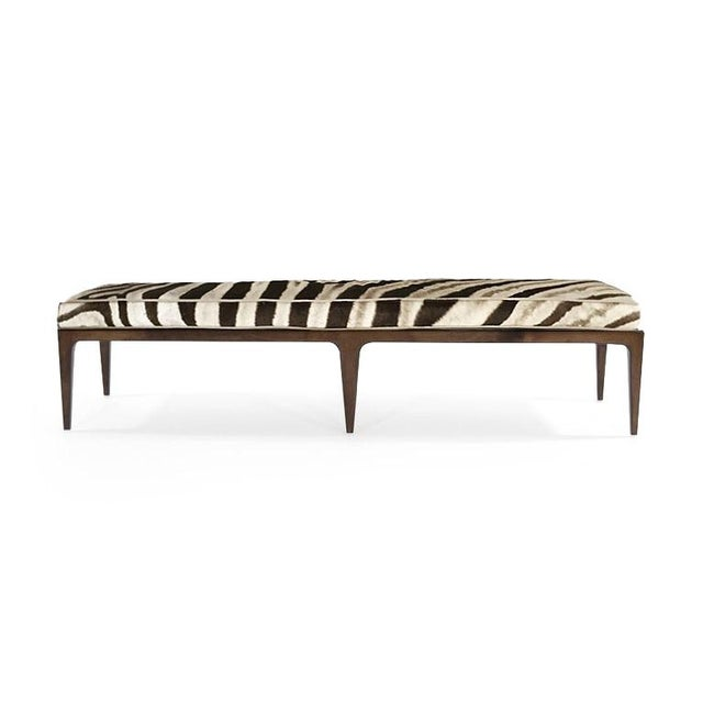 This brilliant, solid walnut Mid-Century Modern bench is upholstered in genuine Zebra hide. The base is solid walnut with...