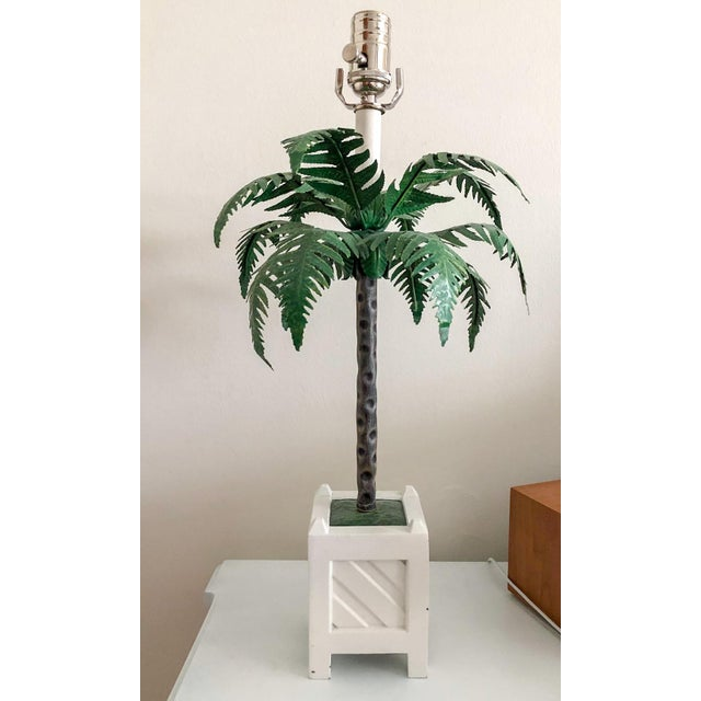 """A rare and stunning pair of Maison Baguès palm tree tole lamps in Chippendale planters. Each to the top of the socket, 21""""..."""
