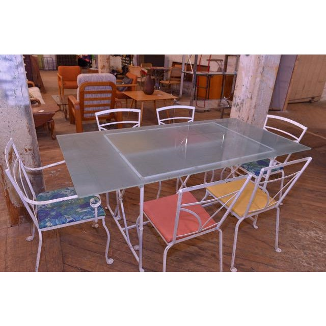 Excellent Salterini style rod iron seasonal/outdoor dining set. 6 chairs with original seat covers. Glass table sets on...