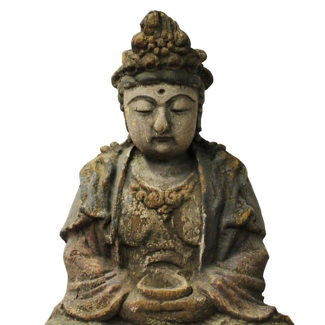 This is a Chinese decorative wooden Sitting Kwan Yin statue. It is finished in vintage rustic look. There are detail motif...