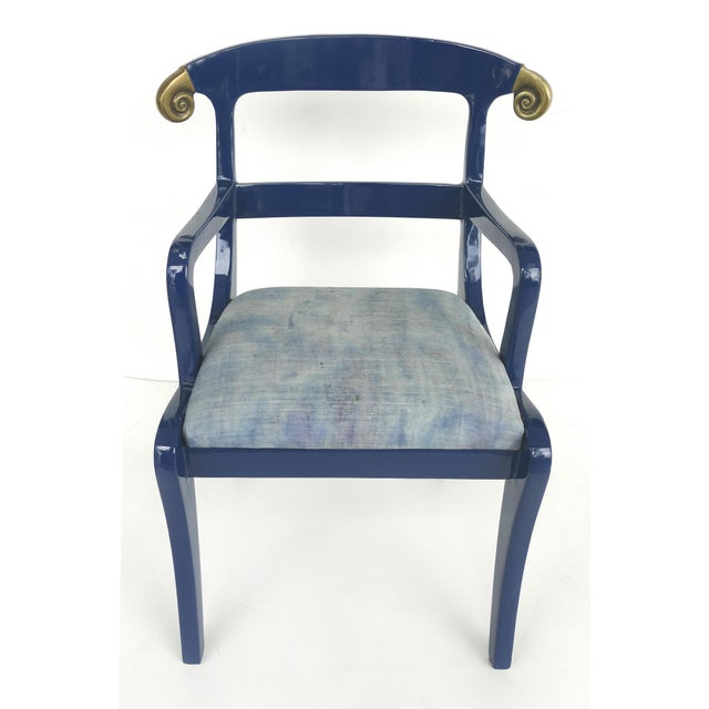Offered for sale is a pair of 1980s blue lacquer armchairs with ram's horn Klismos backs. The chairs are lacquered in blue...
