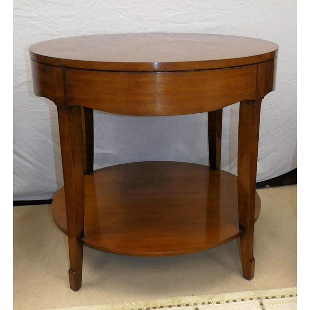 Barbara Barry skirted end table. Features a lovely scalloped apron with four gently splayed legs joined by an under tier....