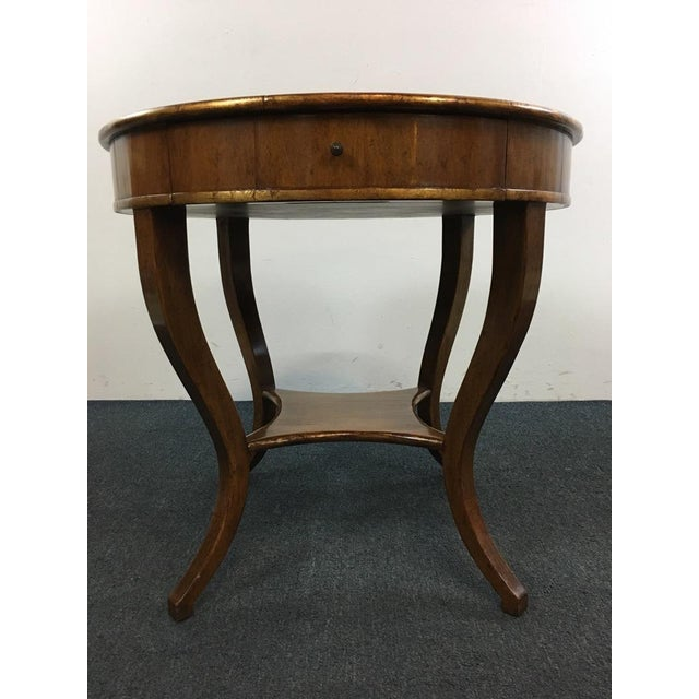 Pair a sofa or chair with this classic Vintage Walnut Veneered Round End Table for a sophisticated look. Graceful, flared...