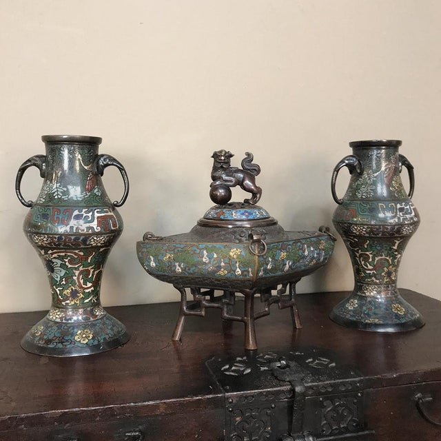 19th Century Japanese Cloissone 3 Piece Mantel Set is a remarkably well-preserved artifact from the period during which...