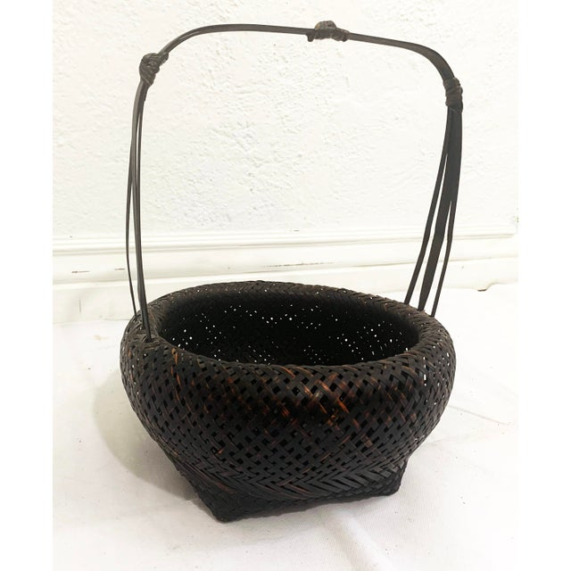 This is a beautiful hand made Antique Japanese Woven Ikebana Basket. It features a round body, with a square base and a...