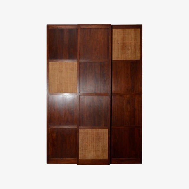3 solid walnut panels with cane insert on wheels. Can be used as a screen or as paneling.