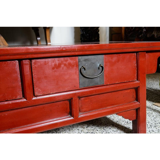 Lovely red Asian coffee table. Drawers push through to both sides.