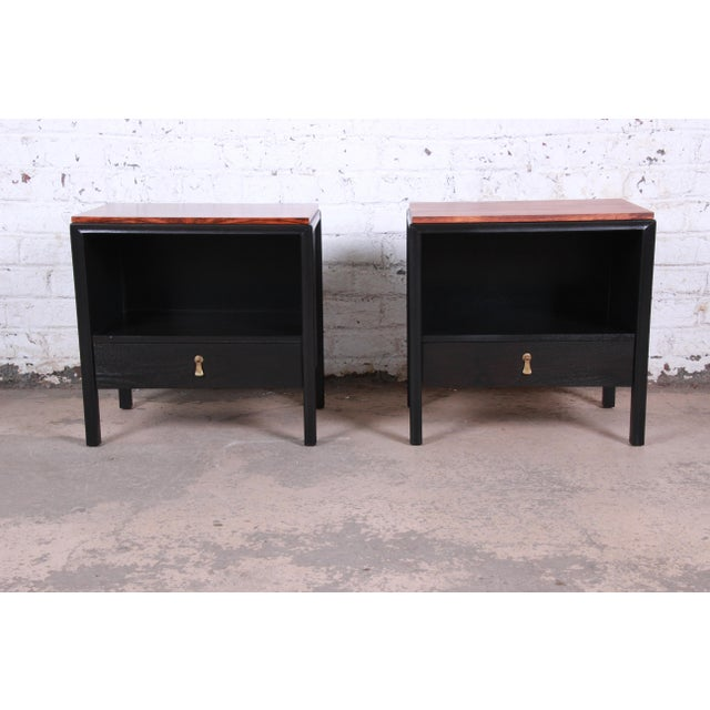 An exceptional pair of mid-century modern nightstands or end tables by John Stuart for Mount Airy. The nightstands feature...