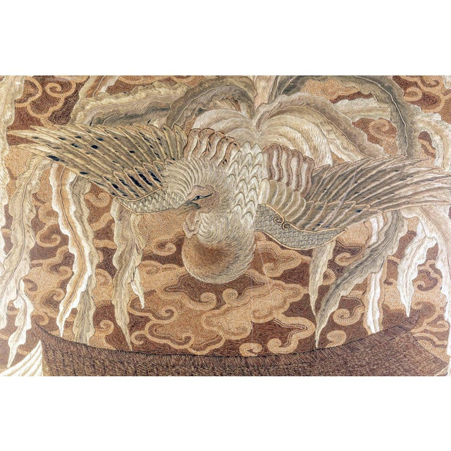 A visually stunning Japanese embroidery tapestry circa 1890s-1900s late Meiji period, presented with a linen matt with...