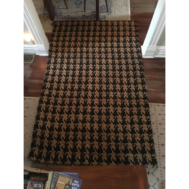 Awesome Hounds Tooth handspun jute rug by Classic Home! This is a great looking classic that works in every decor. It was...