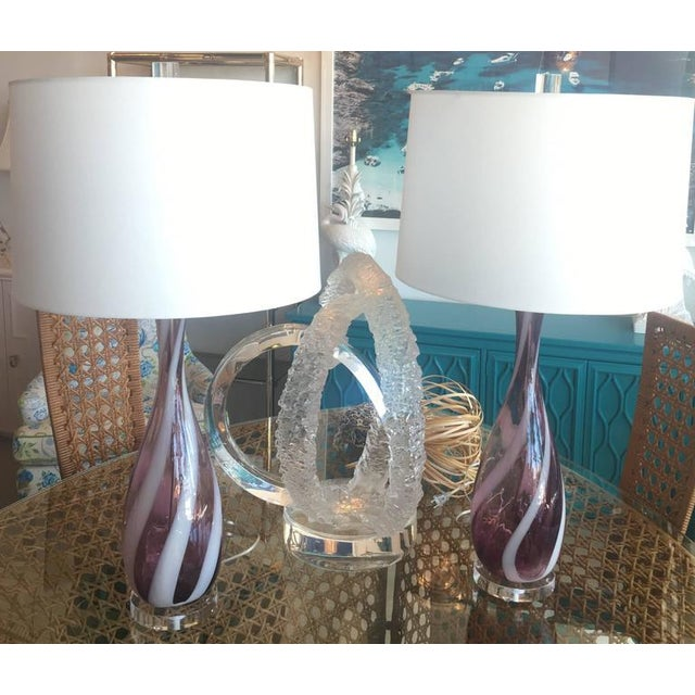 Amazing pair of vintage 1950s Italian Murano glass table lamps. Amethyst purple and white swirl color glass with Lucite...