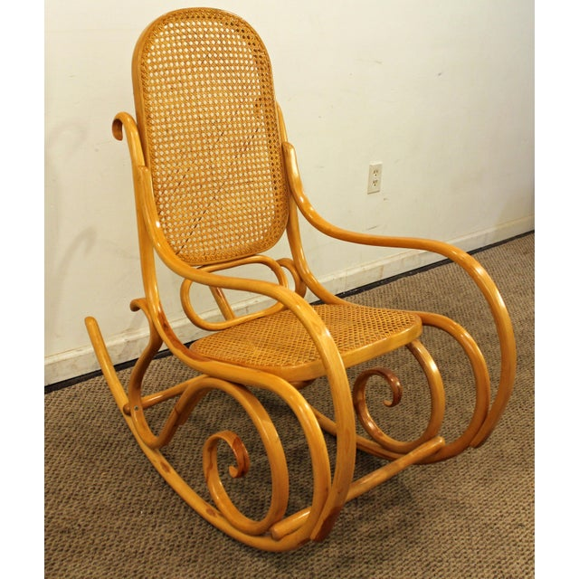Mid-Century Modern Thonet Bentwood Rocking Chair Offered is an great find: a Mid-Century Modern Thonet Bentwood Caned-Seat...
