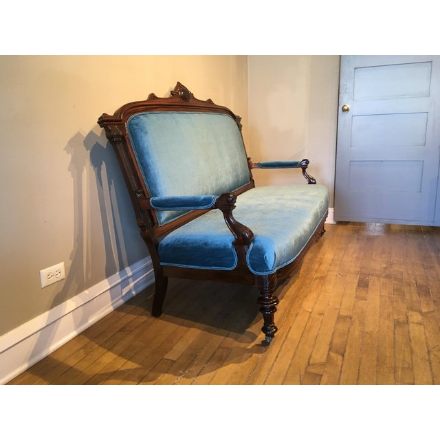 A wonderful rare period piece. Beautifully carved and shapely rosewood c. 1880's Victorian sofa. It has recently been...