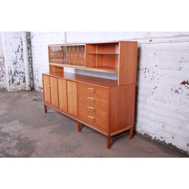An exceptional mid-century modern sideboard with hutch top designed by Kipp Stewart for his Sun Coast line for Drexel...