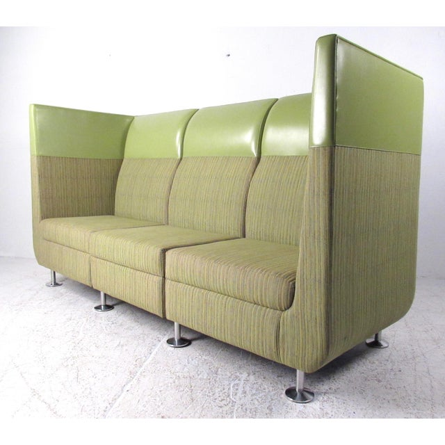 This unique modern sofa features three-seat sectional design in a mixed green covering. Chrome finish legs and clean...