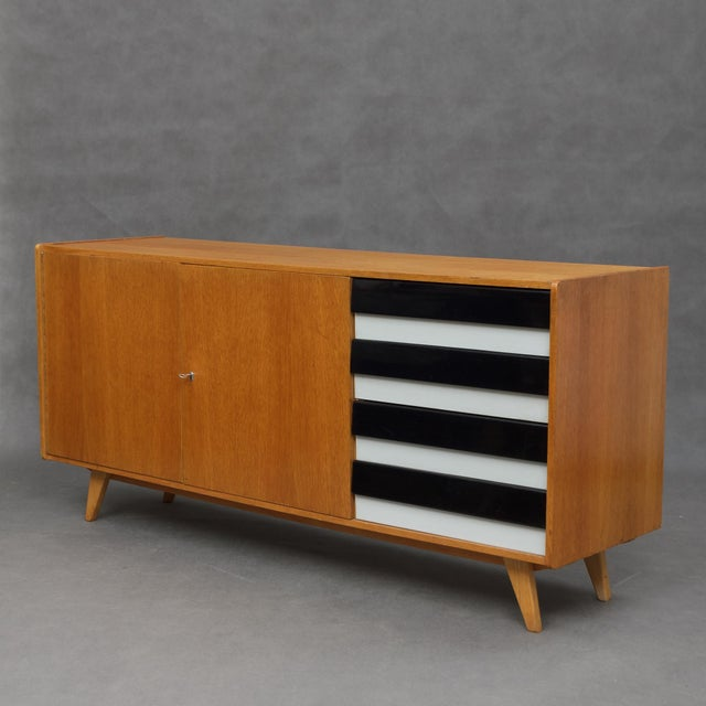 This sideboard was made in non existing today state of Czechoslovakia by Interier Praha. This model is associated with...