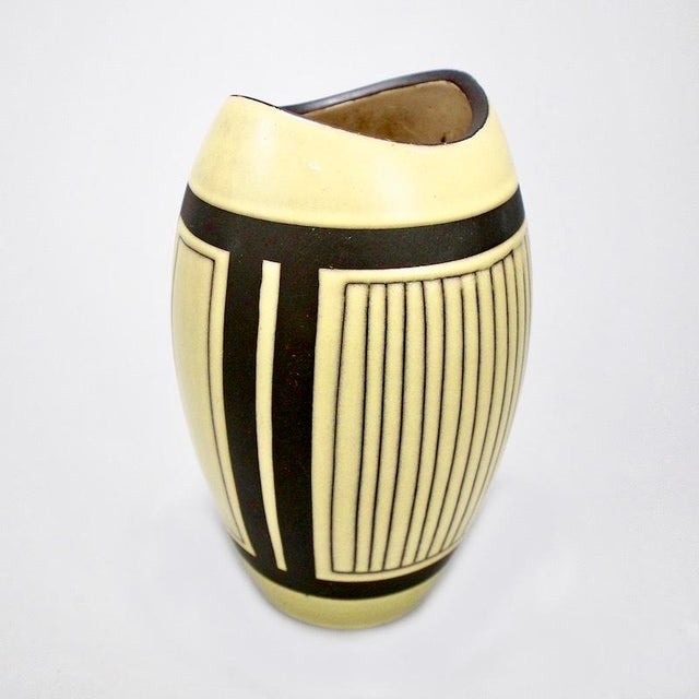 Circa 1950s European ceramic vase by unknown maker - probably German - in dark brown and pale yellow glaze and design....