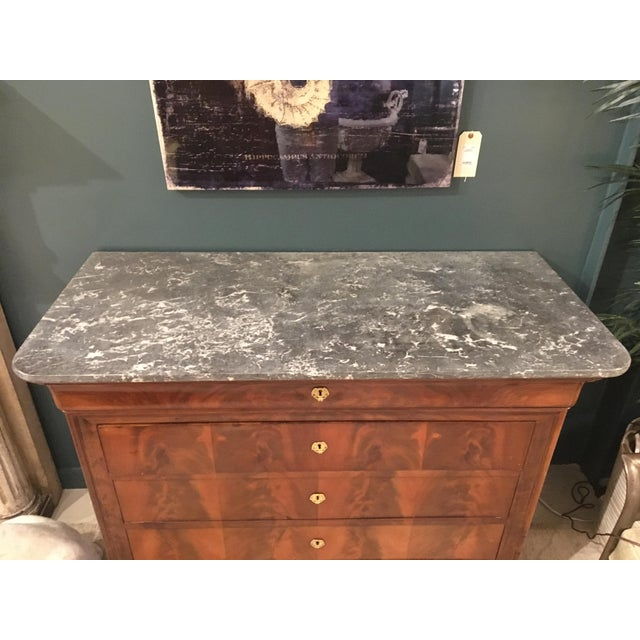 Chest of drawers with marble top.