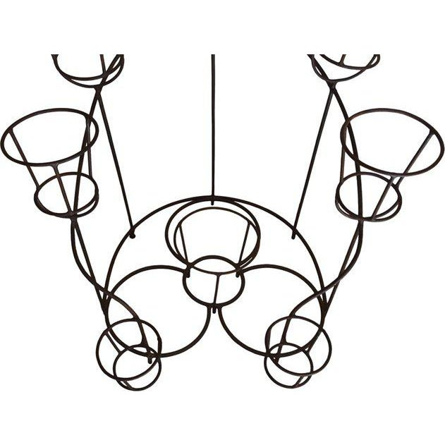 A large French wrought iron plant stand dating from the middle of the 20th century. It has an unusual horseshoe form with...