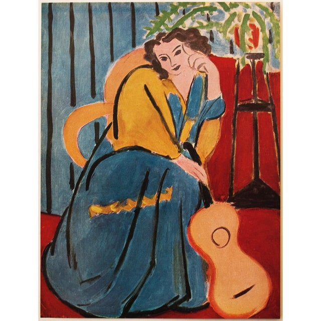 """A rare tipped-in original period offset lithograph after painting """"Seated Woman with a Guitar"""" (1939) by Henri Matisse..."""