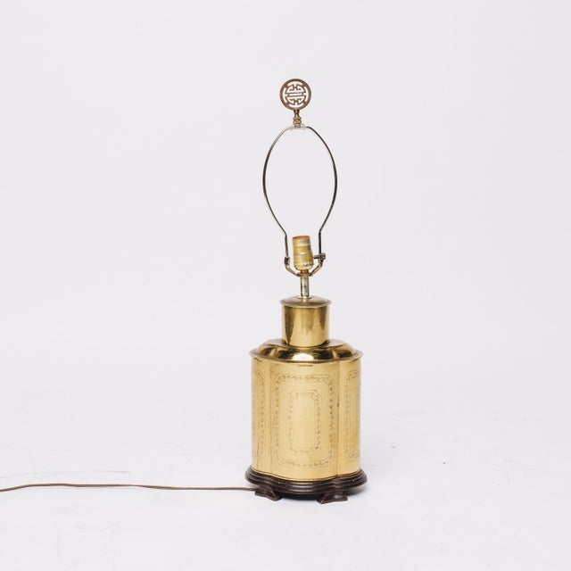 It's brass and regency, therefore I love it. Brass canister sits atop a wood base. Asian/greek key motif finial tops it...