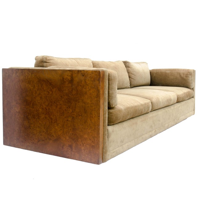 Baughman style sofa with beautiful book matched burl encased sides. Upholstery is an olive-beige color; it has faded and...