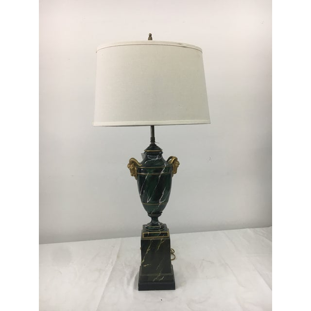 This lamp is restored with no chips or stray marks. It is hand painted in a Malachite motif with two gold ram heads. Base...