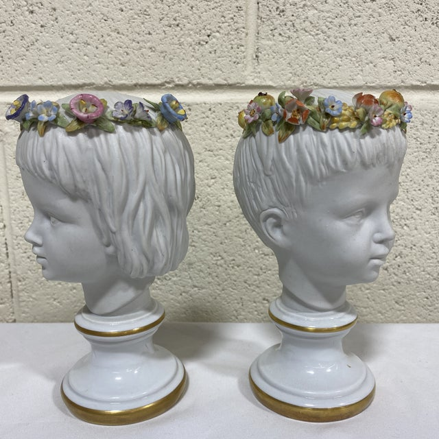 The absolute cutest pair of Capodimonte boy and girl busts with colorful floral crowns. Perfect condition. No chips or...