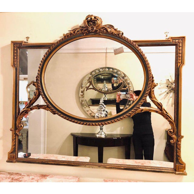 A finely carved Hollywood Regency or Adams style over the mantel (fireplace) or wall mirror. This stunning and one of a...