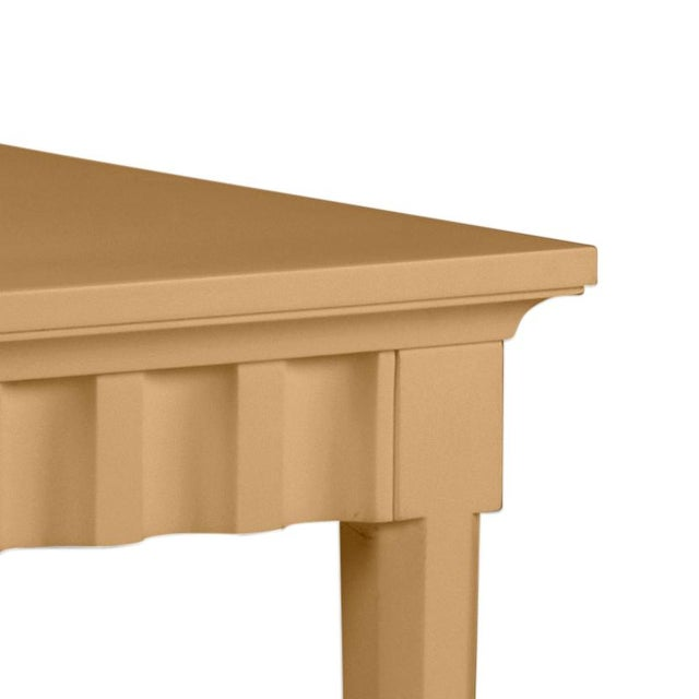 Scallop pattern design on console and finish is Benjamin Moore Mystic Gold. Made of acacia wood.