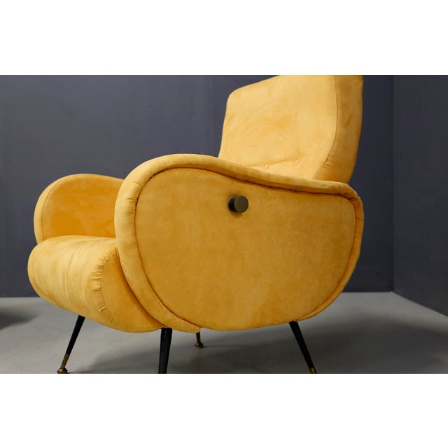 Pair of restored mid-century Italian armchairs from 1950. The armchairs are lined in yellow velvet. The particularity of...