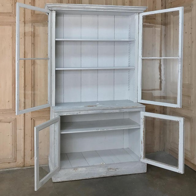 Antique Swedish Scraped Painted Bookcase is a grand way to display your books, memorabilia or collection. Classic...