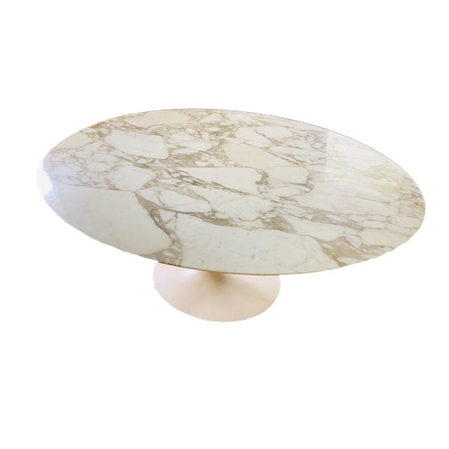 A large Knoll Saarinen marble-topped tulip dining table. The table was designed by the architect Eero Saarinen and crafted...