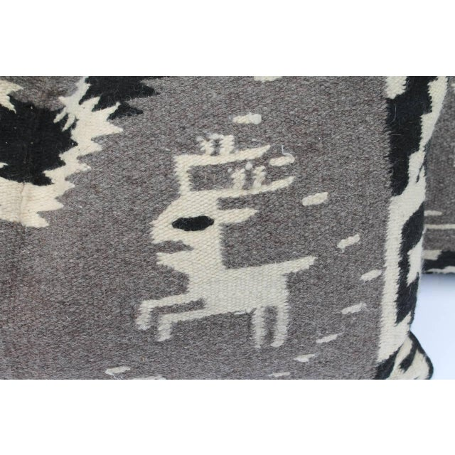 This fun and whimsical pair of Navajo Indian weaving bolster pillows are in great condition with black cotton linen...