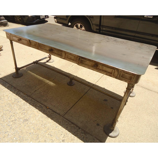 Fantastic metal desk with double side drawers. Heavy frame and legs and well worn top. (Please confirm item location NY or...