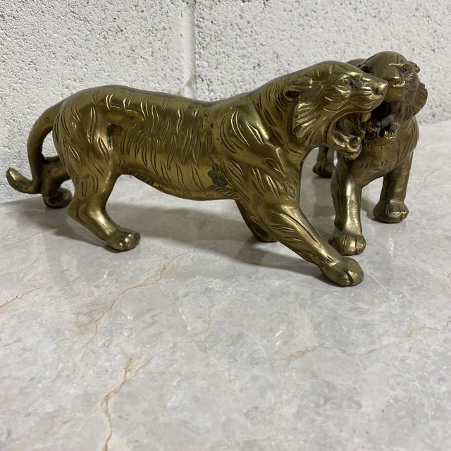 CB killed her husband, whacked him.. . . are you a Tiger King fan? Here's your souvenir. Pair brass tigers. Great...