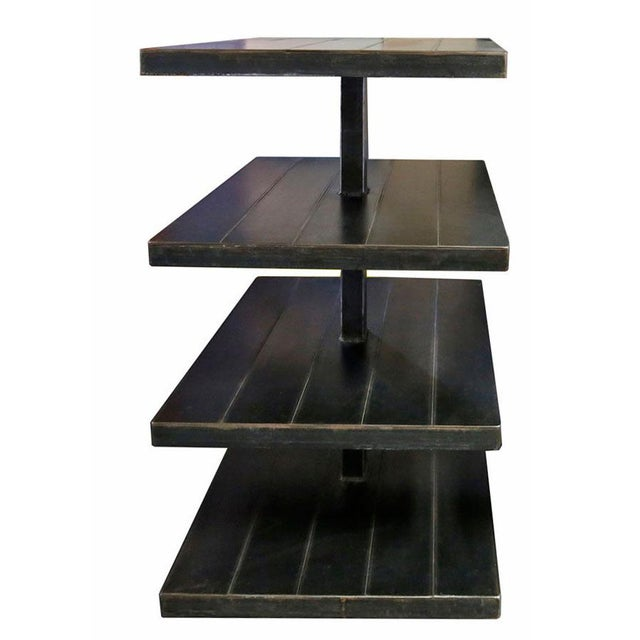 Black metal sturdy shelving unit on wheels. Shelves are square. Great for display.