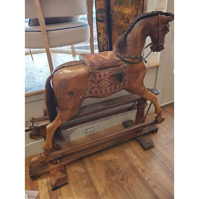 This beautiful 19th century English Rocking Horse has some stories to tell. Made of carved beech and pine polished to a...