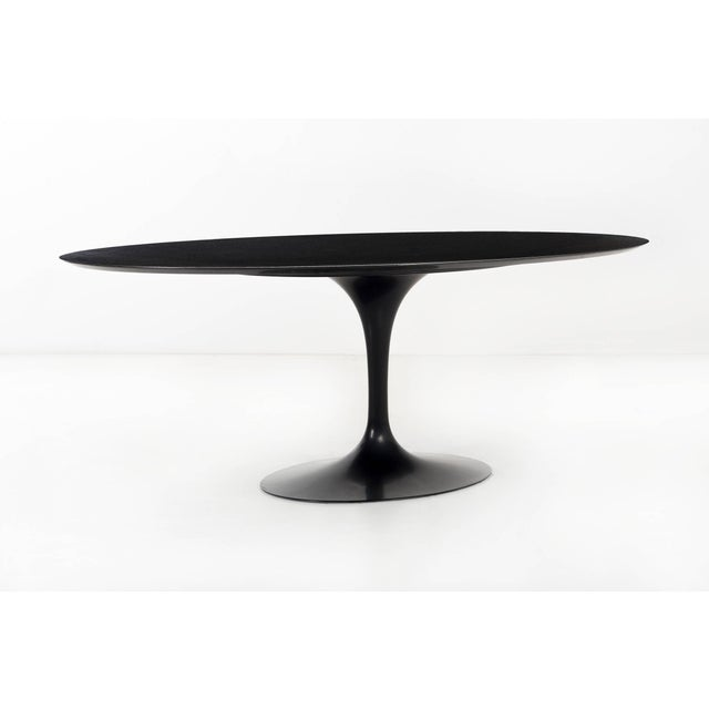 """A """"Modern Classic"""" Eero Saarinen pedestal dining table, custom black granite with painted aluminum Sub-base filled with..."""