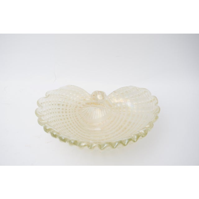 This stylish, large scale Barovier et Toso Murano glass shell shaped dish was acquired from a Palm Beach estate. For trade...