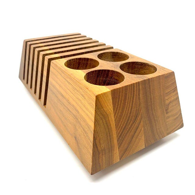 Mid-century modern geometric solid wood desk organizer. The organizer has six slots for letters and files, and four pencil...