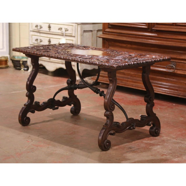 Decorate an entry with this elegant and richly sculpted table. Crafted in Spain circa 1840, the antique table stands on...