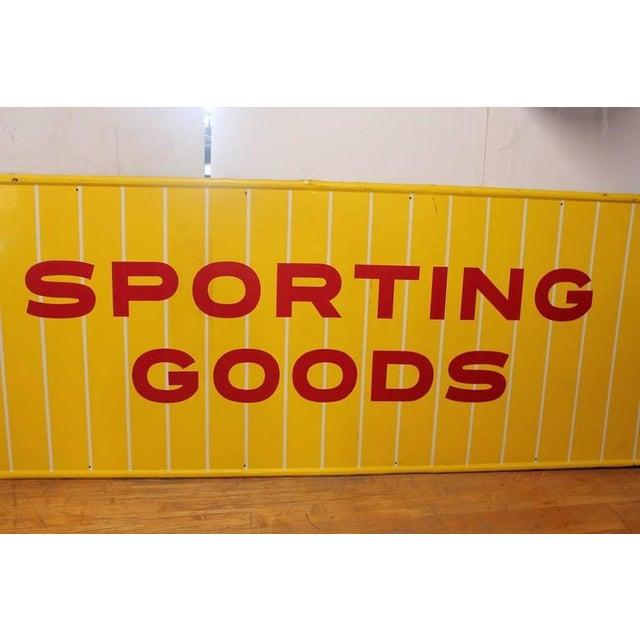 1950s sporting goods metal sign.